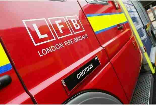 Firefighters perform Emergency First Aid on child in Croydon